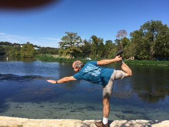 New Braunfels, Texas -- Yoga at the Comal River's edge.