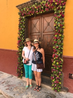 My amiga and I at the doorway of a B&B, decked out in flowers -- a greeting for arriving visitors.